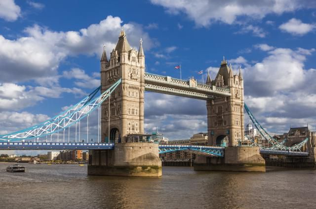 London Bridge Over Thames River Against Cloudy Sky