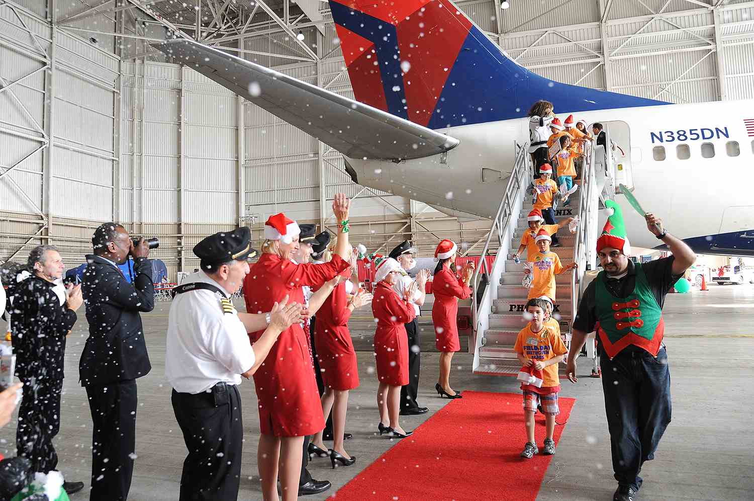 Sarah Hyland And Jordin Sparks Join Delta Air Lines' Annual Holiday In The Hangar Celebration