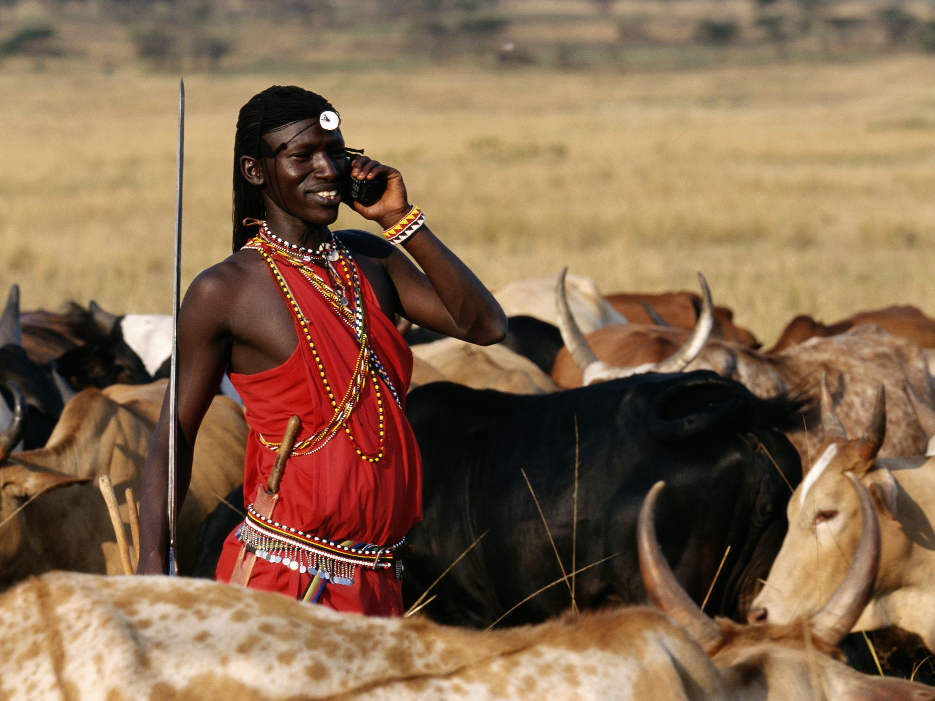 Image result for photo of masai with cell phone
