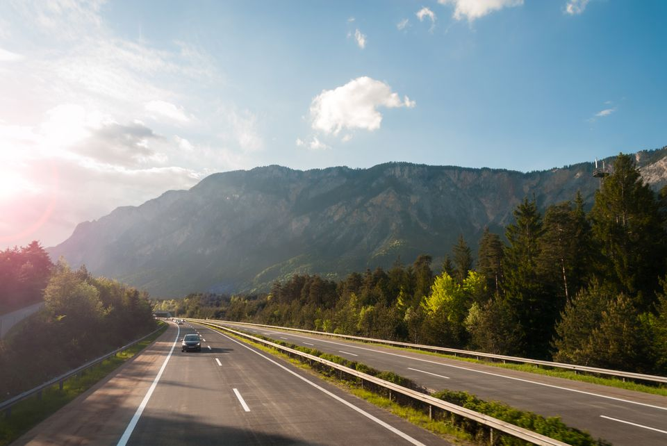 Autobahn in austrian mountains at sunset