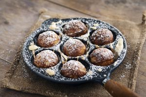 Traditional round danish pancakes in a specialty pan