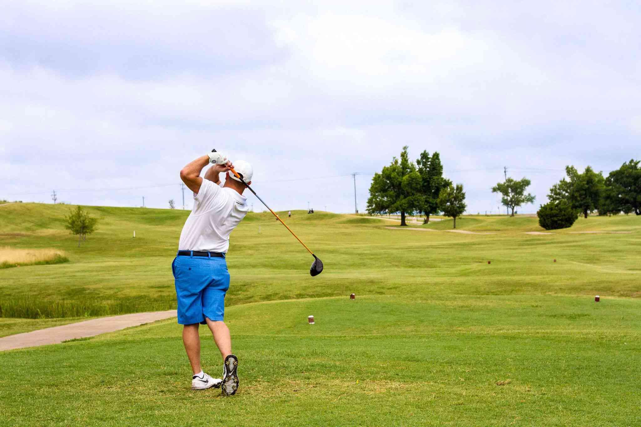 ManpPlaying golf at Crimson Creek Golf Course