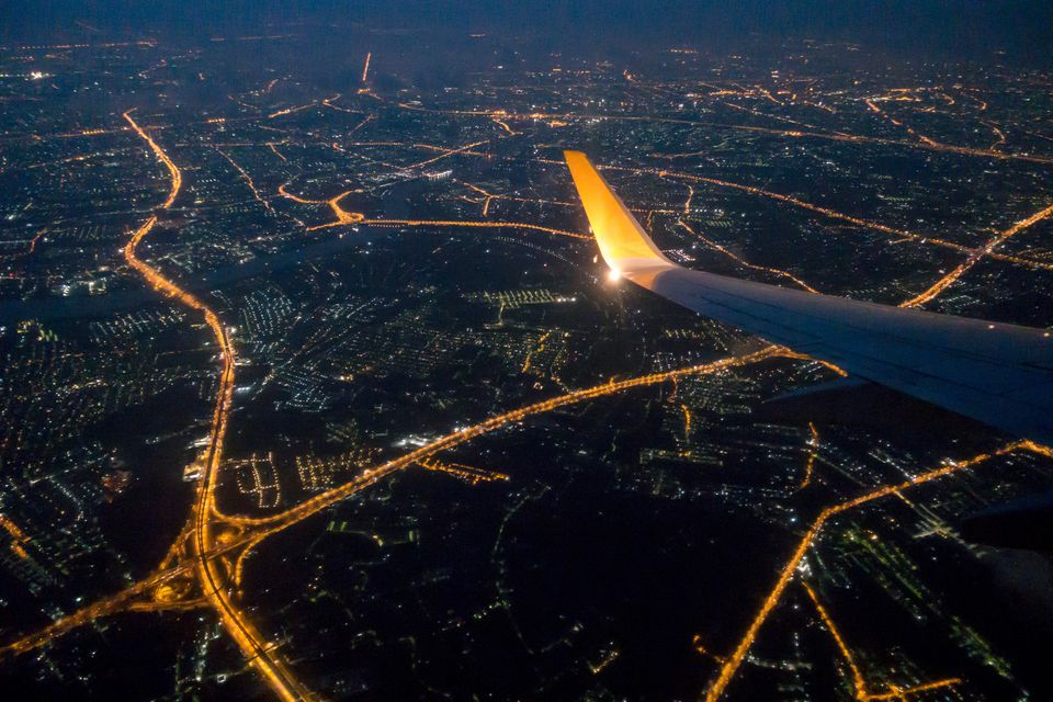 Bangkok city night view via aircraft window