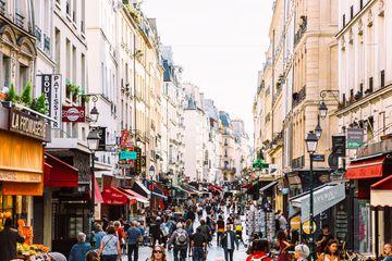 Crowds of people at Rue Montorgueil pedestrian street in Paris, France