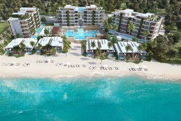 Aerial exterior view of Alaia Belize and beach