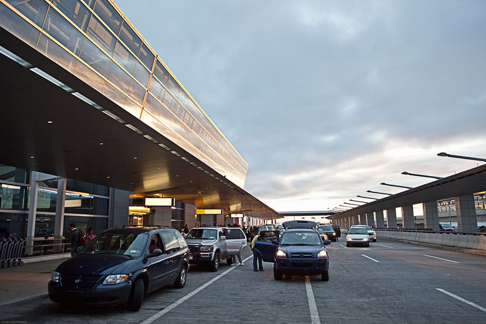 Cars at the passenger drop-off area at an airport