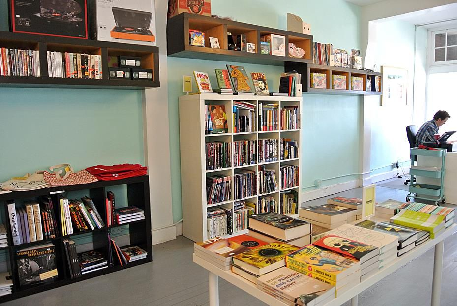 dozens of books on shelves in a small bookstore