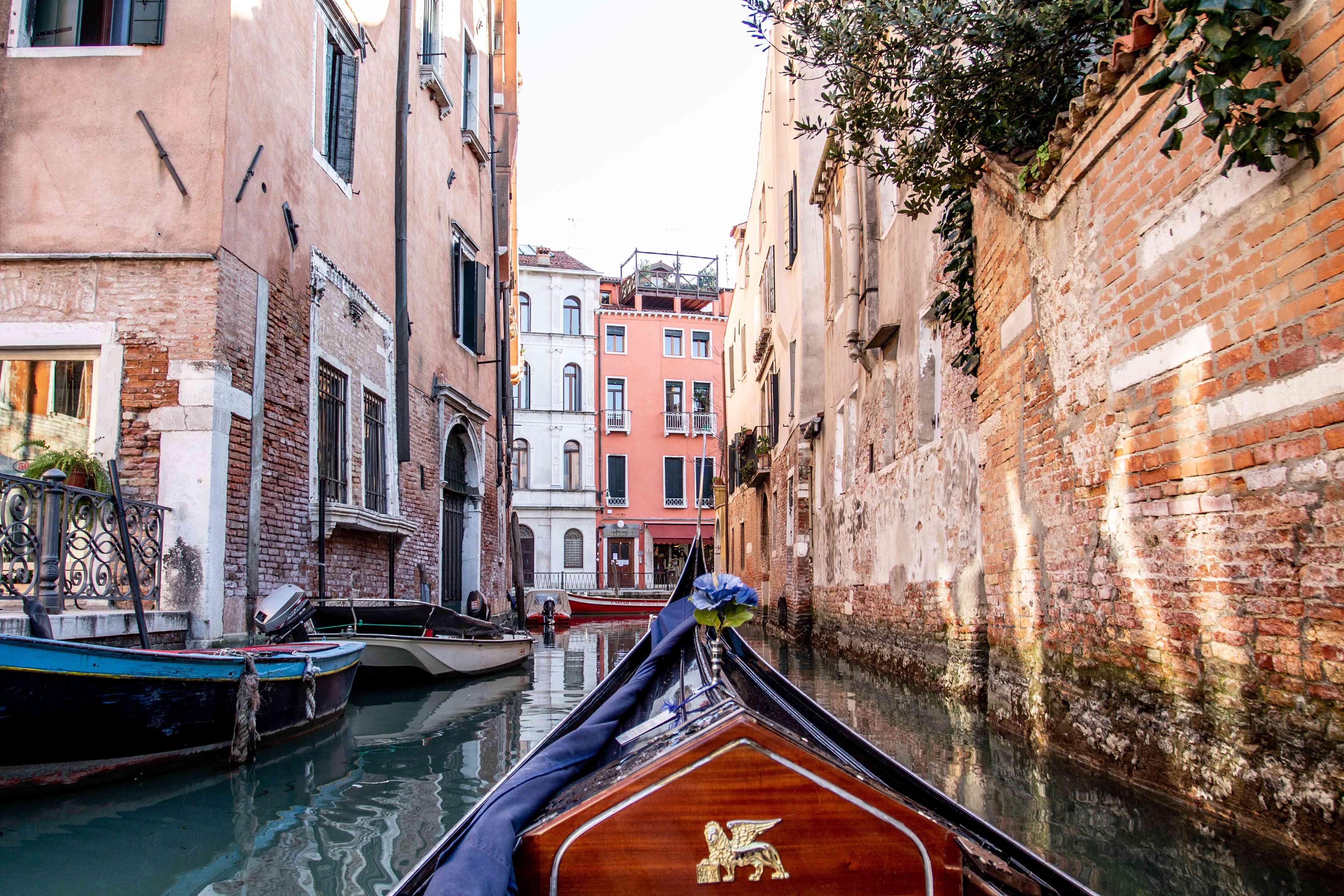 A POV shot of a gondola ride through Venice
