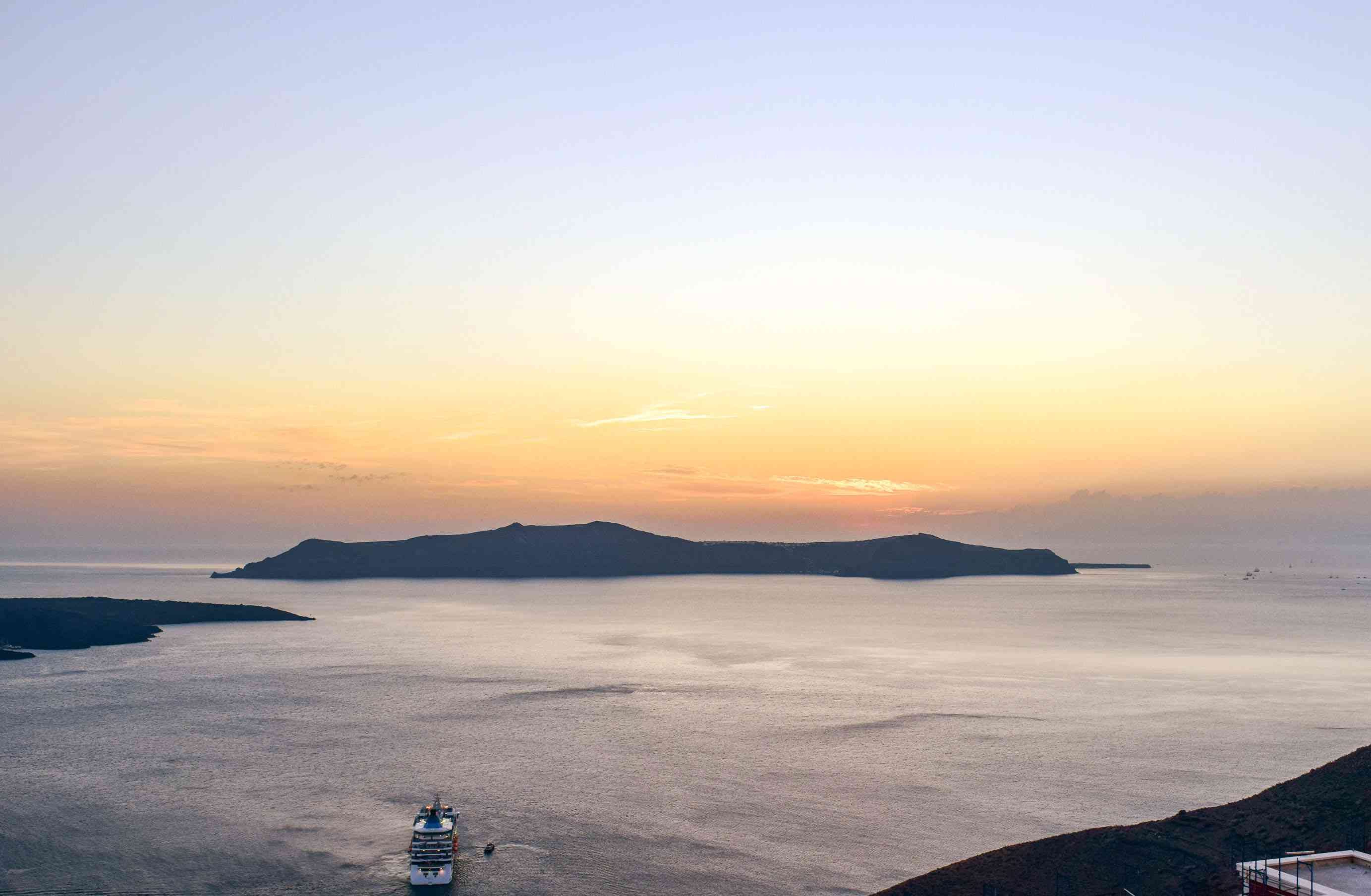 View of the sunset off the coast of Santorini
