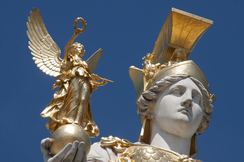 Statue of Nike, Greek goddess of victory, held by Athena, goddess of war.