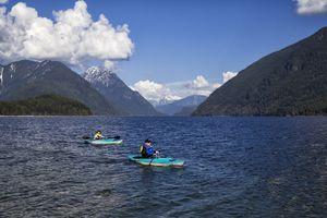Couple kayaking at Alouette Lake, BC, Canada
