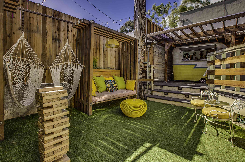 Jumbo jenga on an astro turfed outdoor patio at Good Times at Davey Wayne's