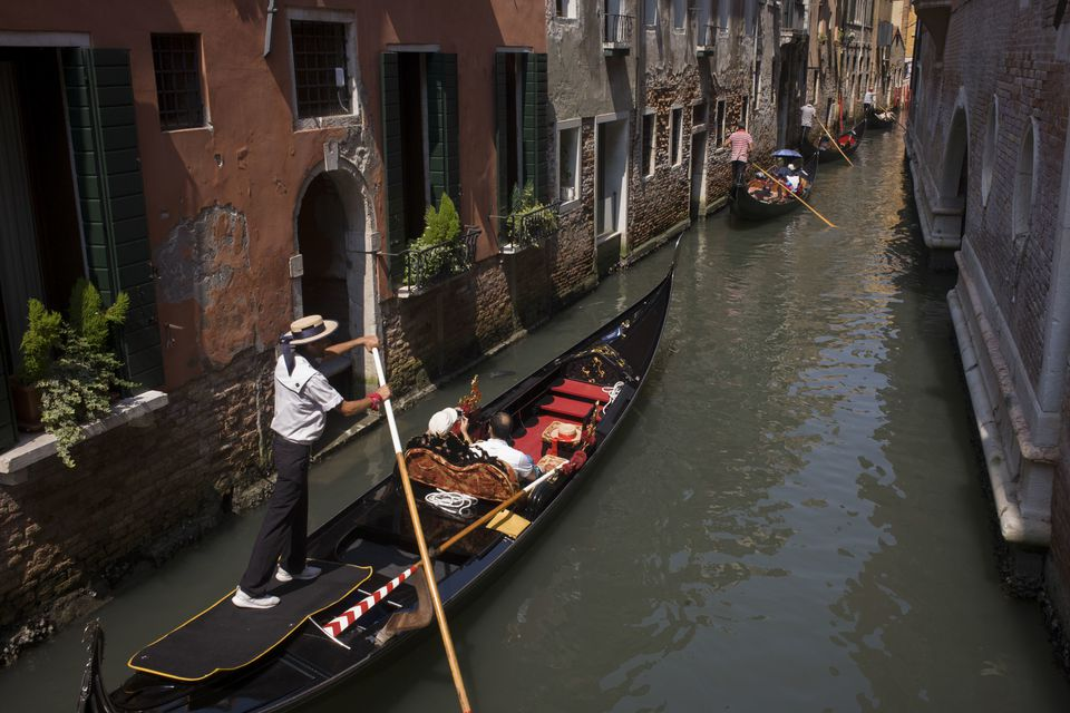 A Gondola traveling down the canal in Venice