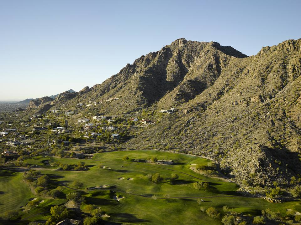 Aerial photograph of Camelback Mountain overlooking golf course.