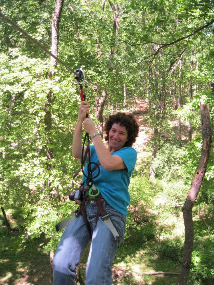 Woman riding zip line