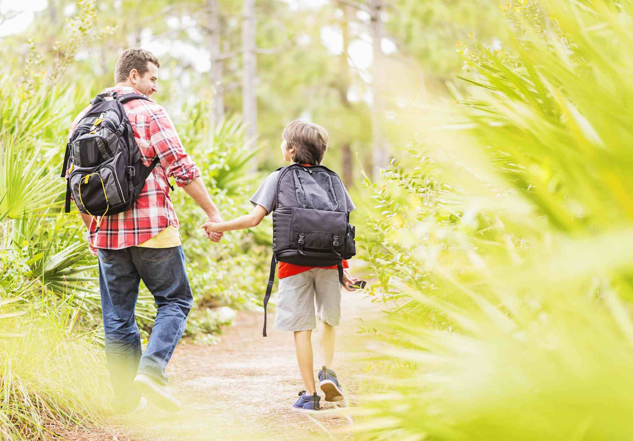 Father and son hiking in Juniper, Florida