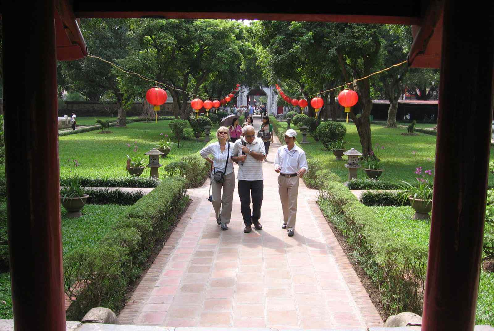 Tourists crossing the first courtyard, Temple of Literature, Hanoi, Vietnam