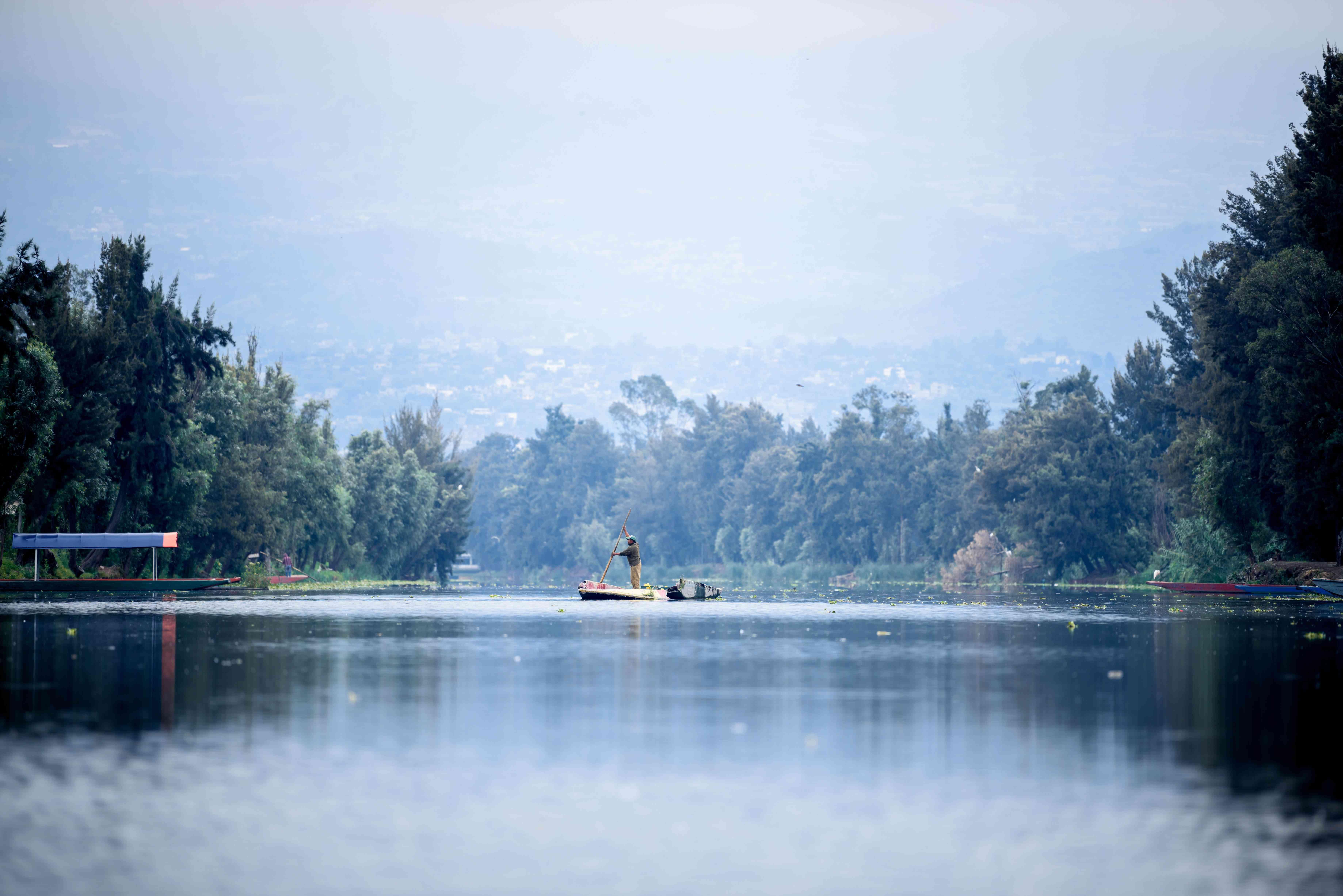 man rowing a canoe in Xochimilco