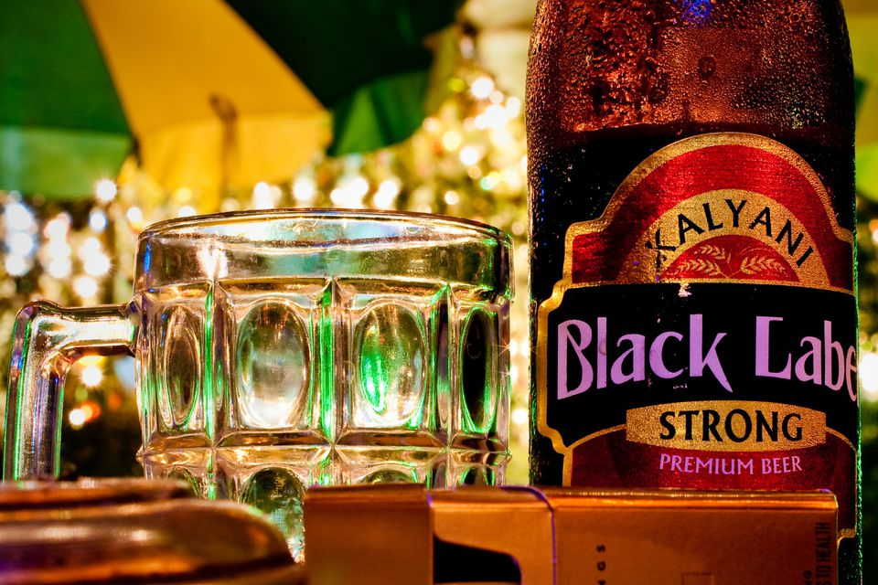 It's just a picture of Vibrant Black Label Beer Price Tops