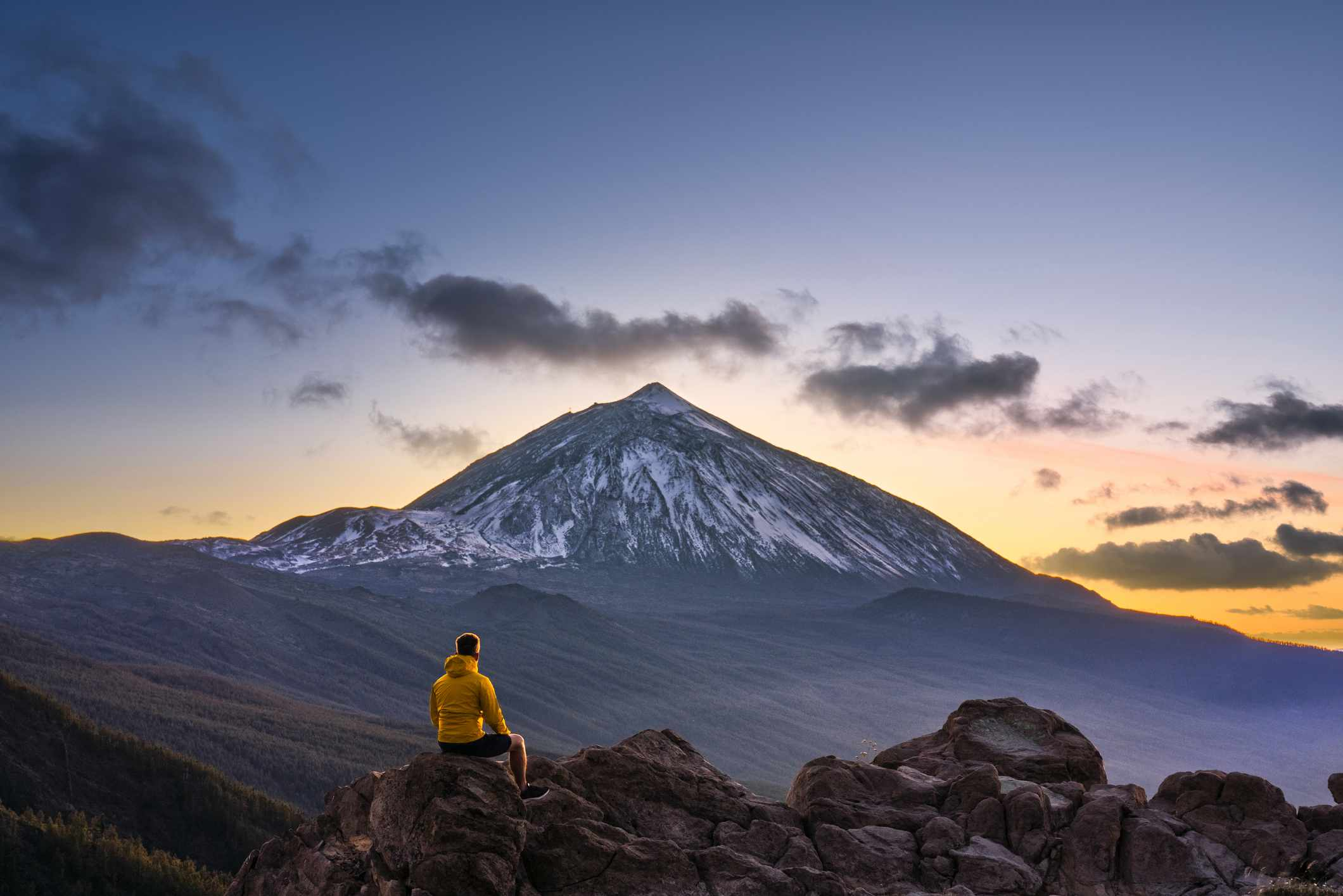 Man admiring the view of volcano Teide at dusk. Tenerife, Canary Islands, Spain