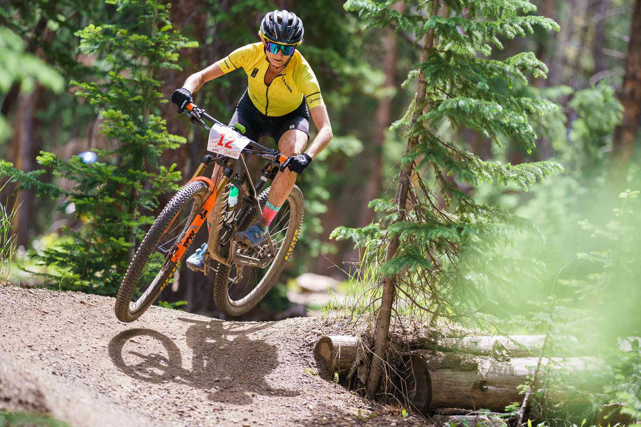 Professional mountain biker displays the proper body position on a downhill turn
