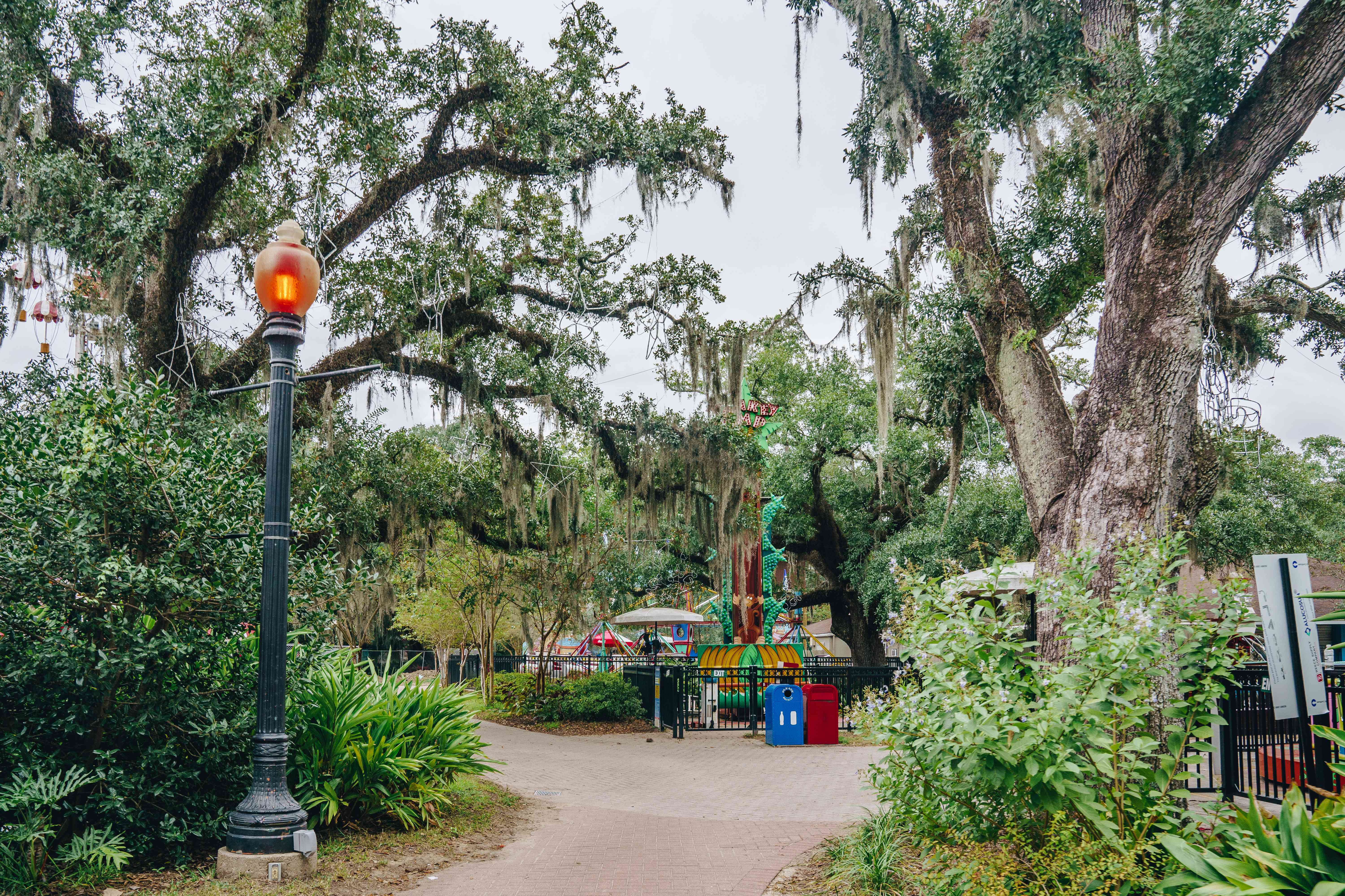 a walkway leading up to rides at the Carousel Gardens Amusement Park