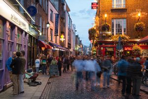 People stroll through Temple Bar district at dusk, Dublin, Ireland
