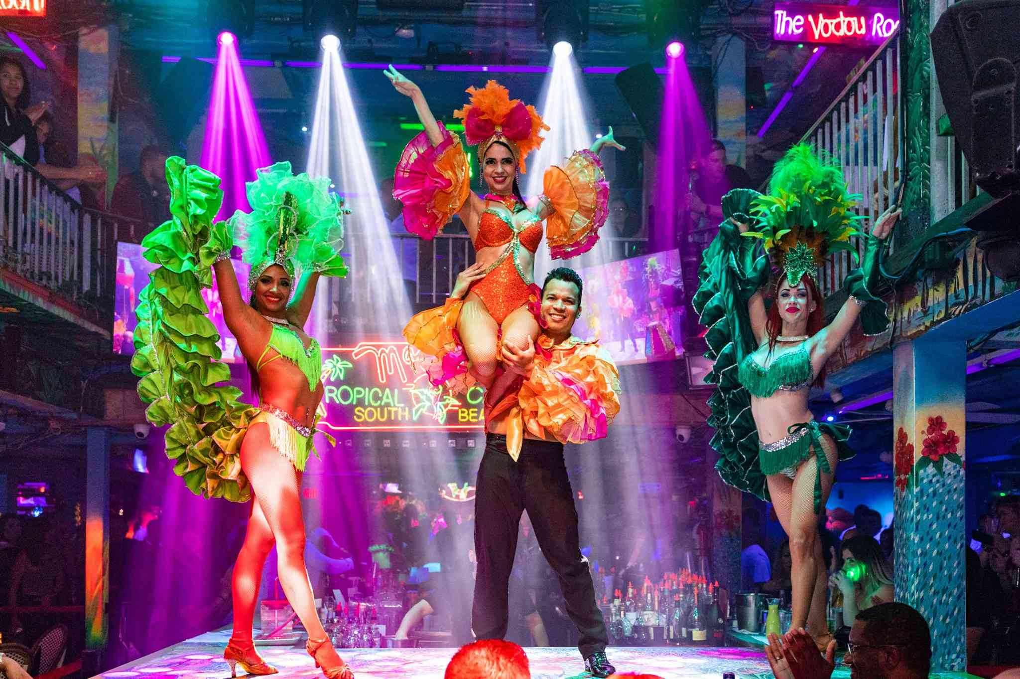 Dancers with colorful flamboyant costumes at Mango's