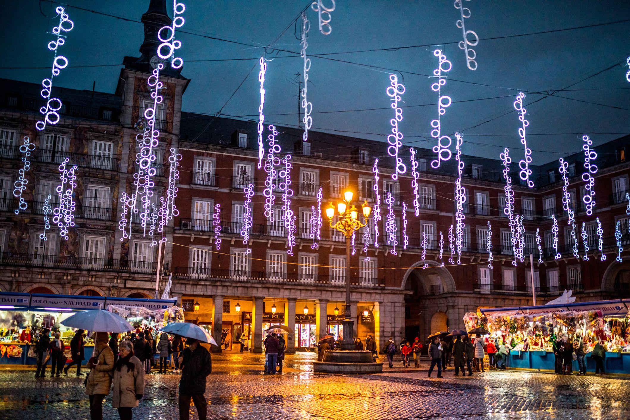 People buying gifts at the Plaza Mayor Christmas Market, Madrid