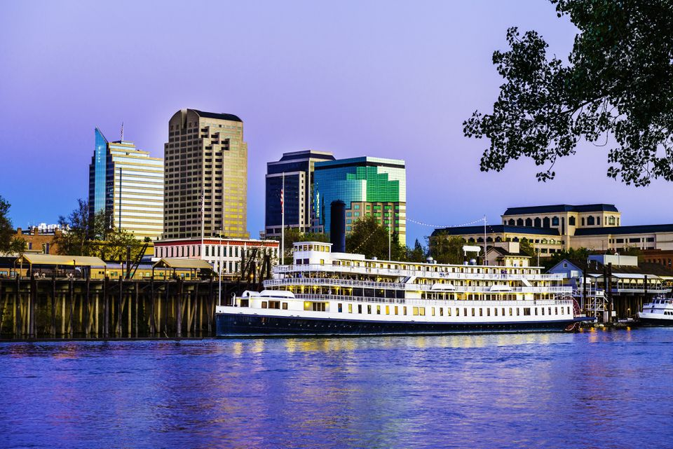 Sacramento skyline and riverfront at dusk