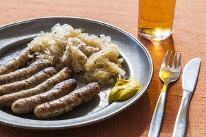 Nuremberg grilled sausages, sauerkraut and mustard on plate
