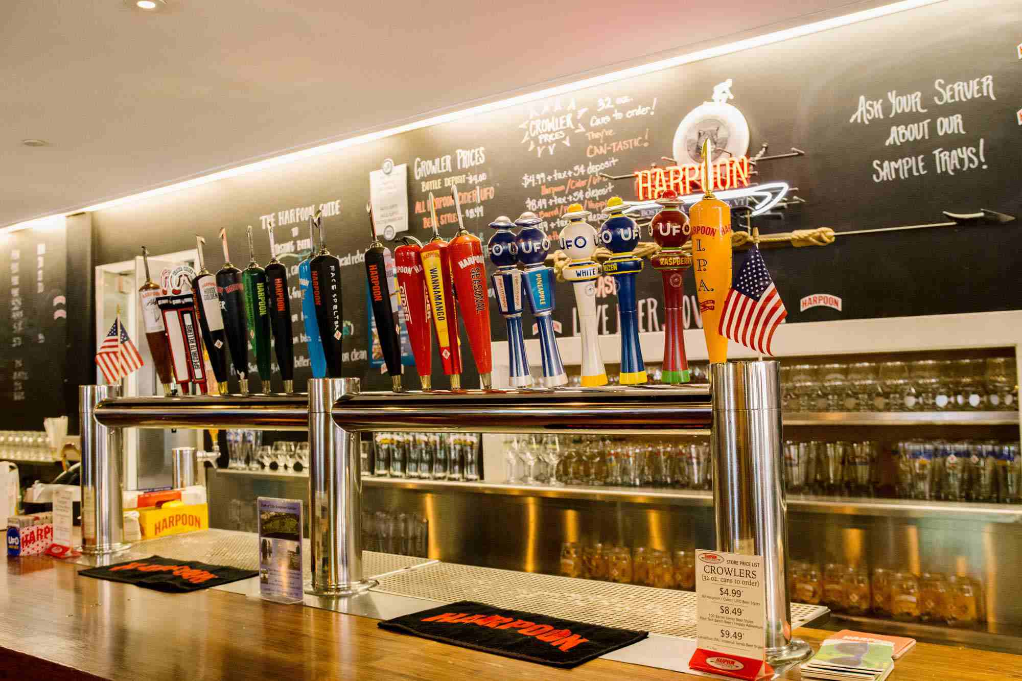 Collection of 19 colorful beer taps at Harpoon's Windsor, VT brewery