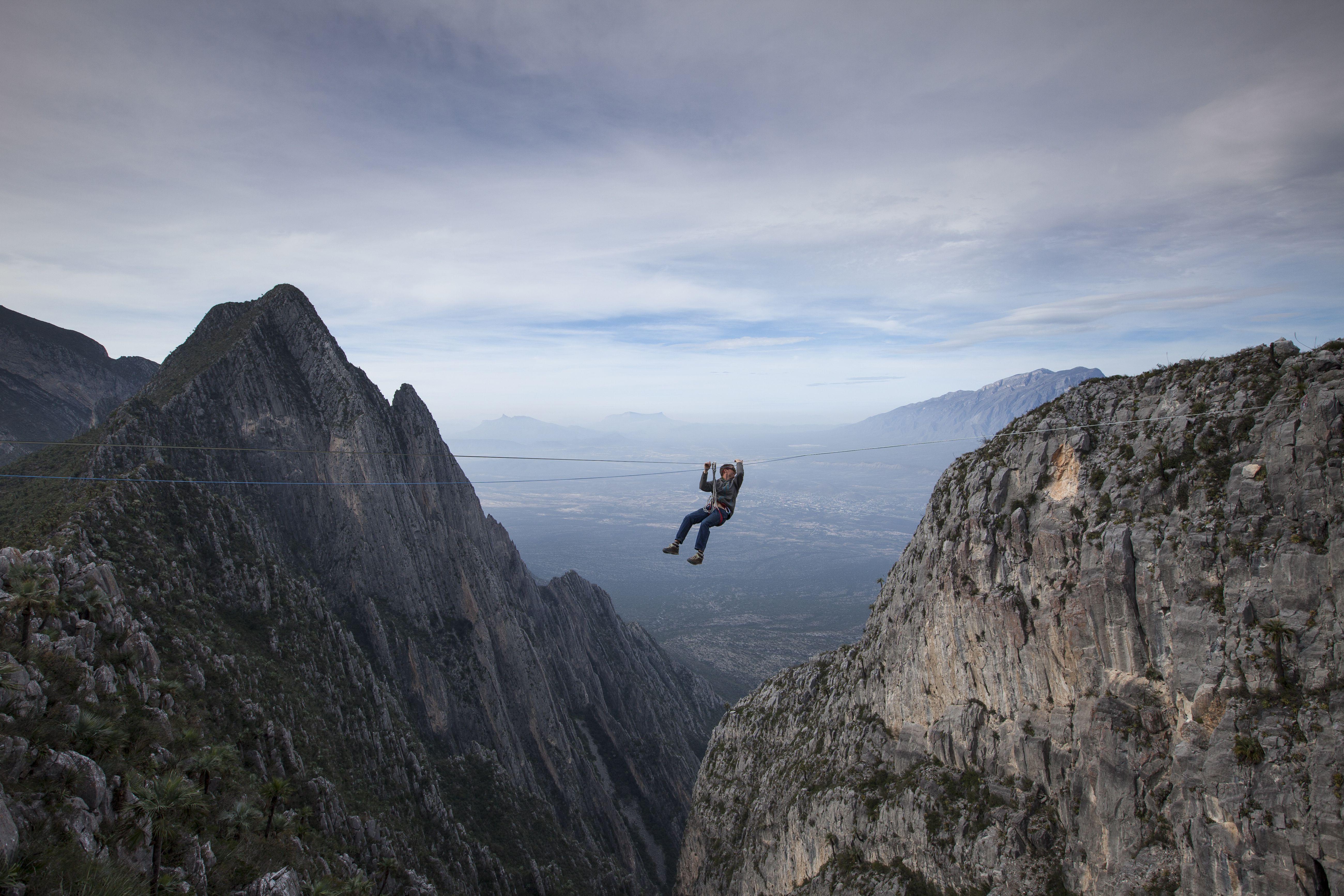 Man Zip Lines Across Canyon