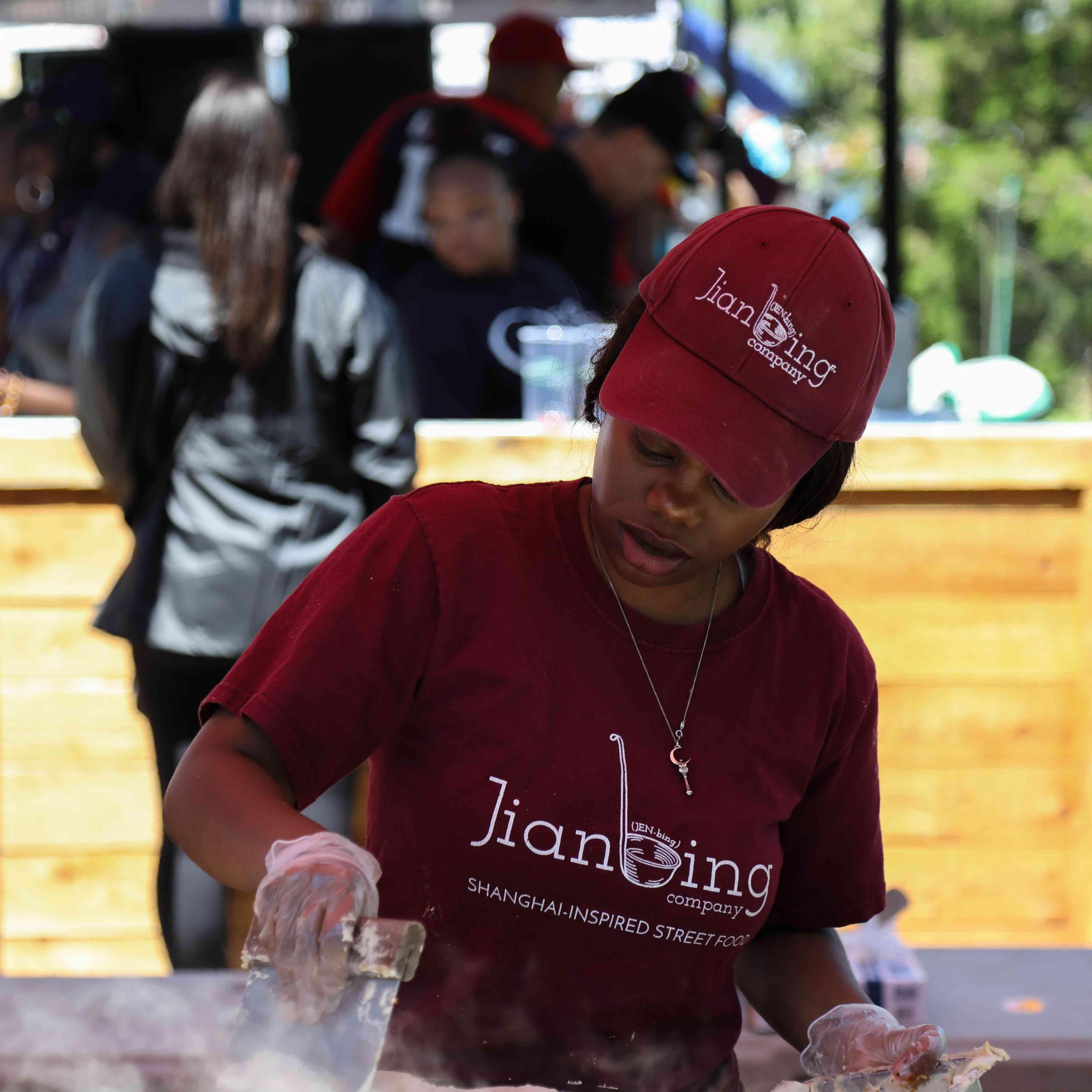 A vendor making fresh food at Smorgasburg