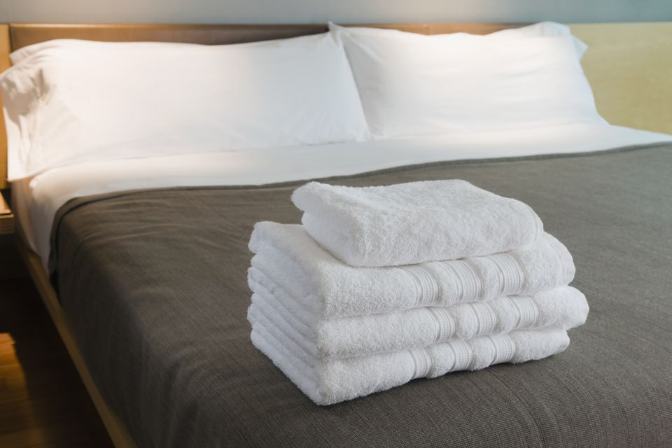 Towels on the bed in a hotel room
