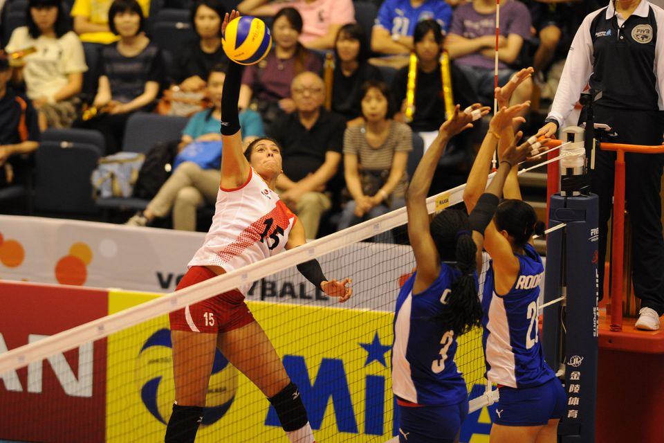 Peru volleyball player spikes during the match between Cuba and Peru at Park Arena Komaki in Komaki, Japan.