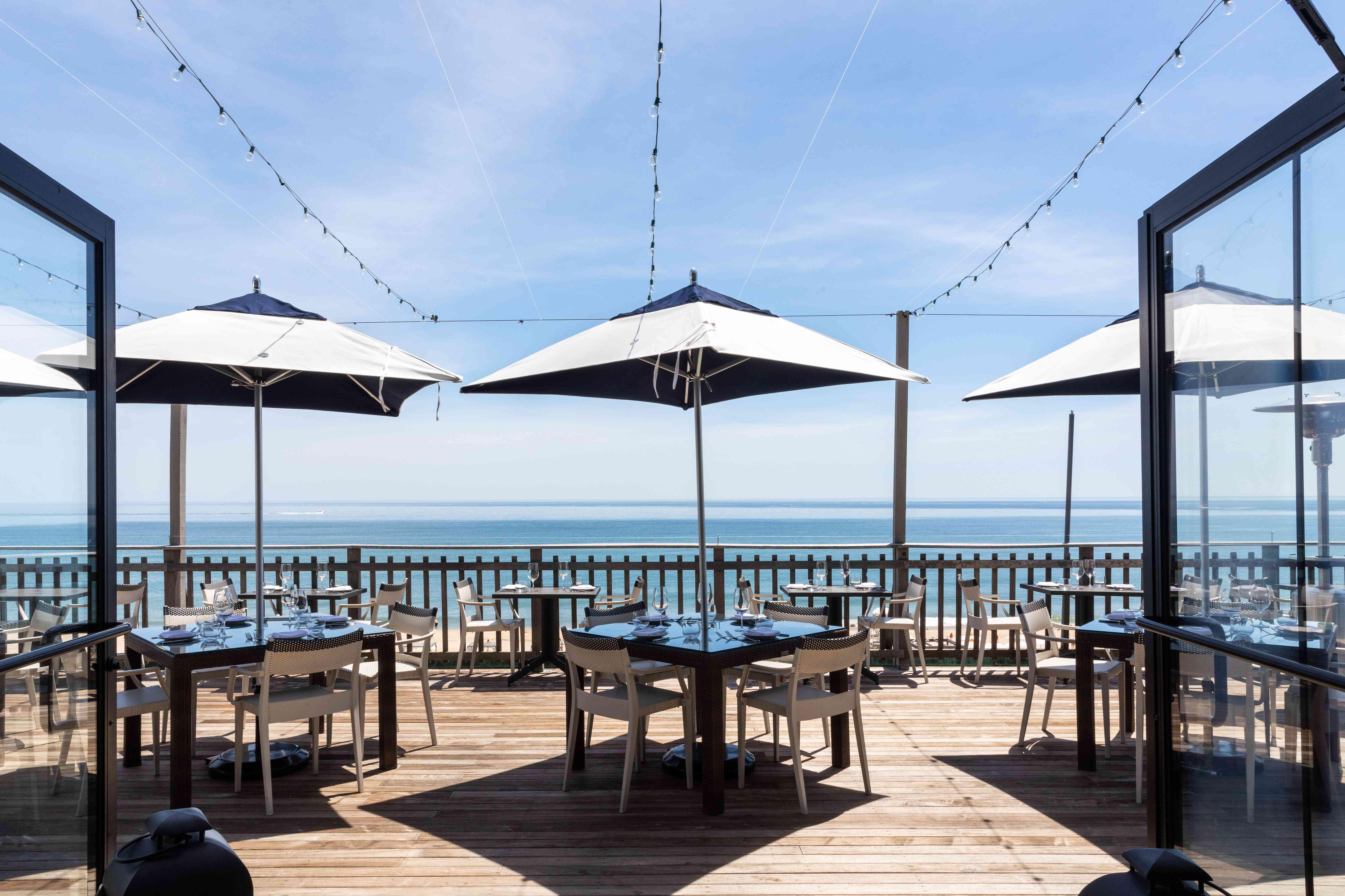 Patio tables overlooking the water at Scarpetta Beach restaurant in Montauk.