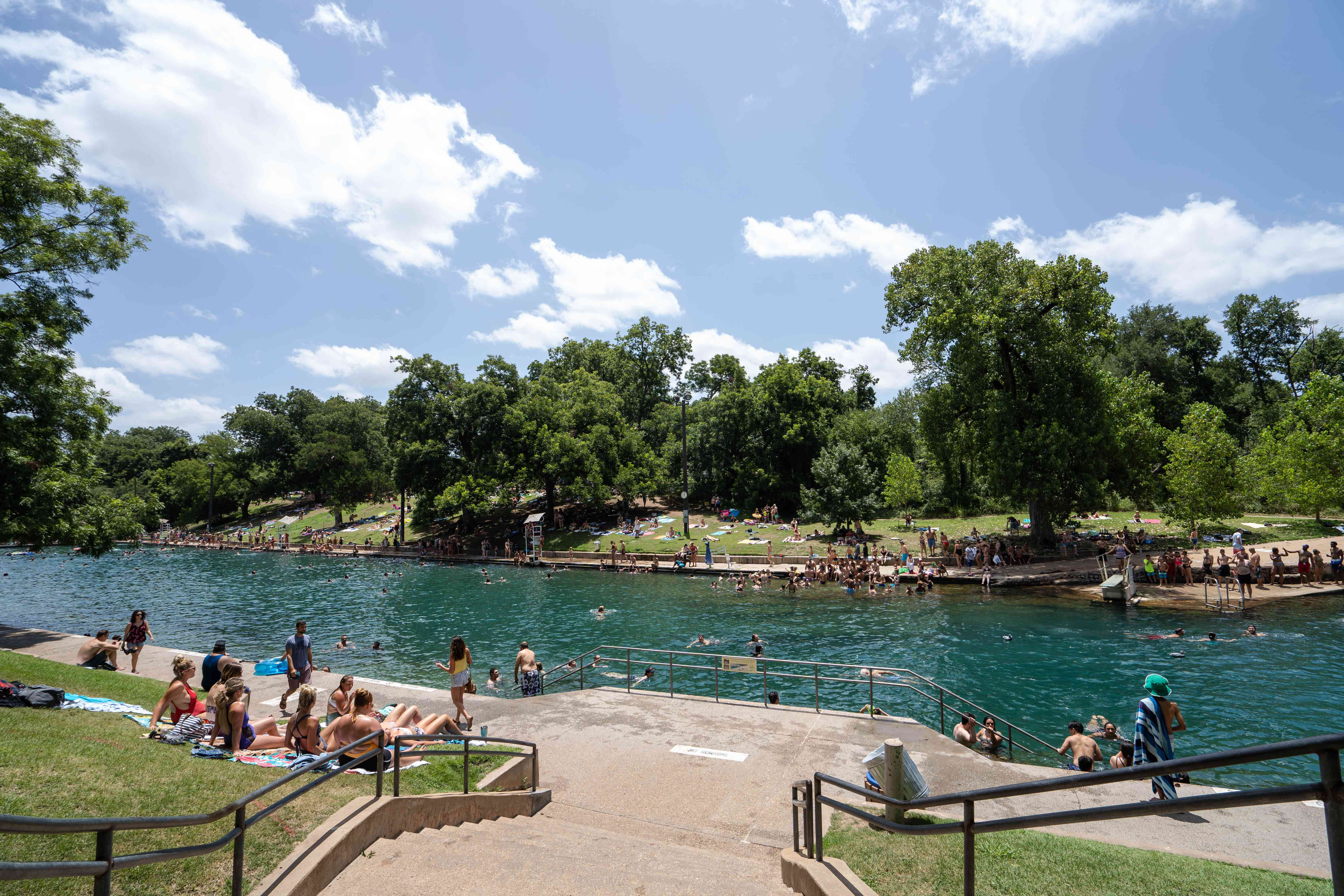 People hanging out on the walkway near Barton Springs