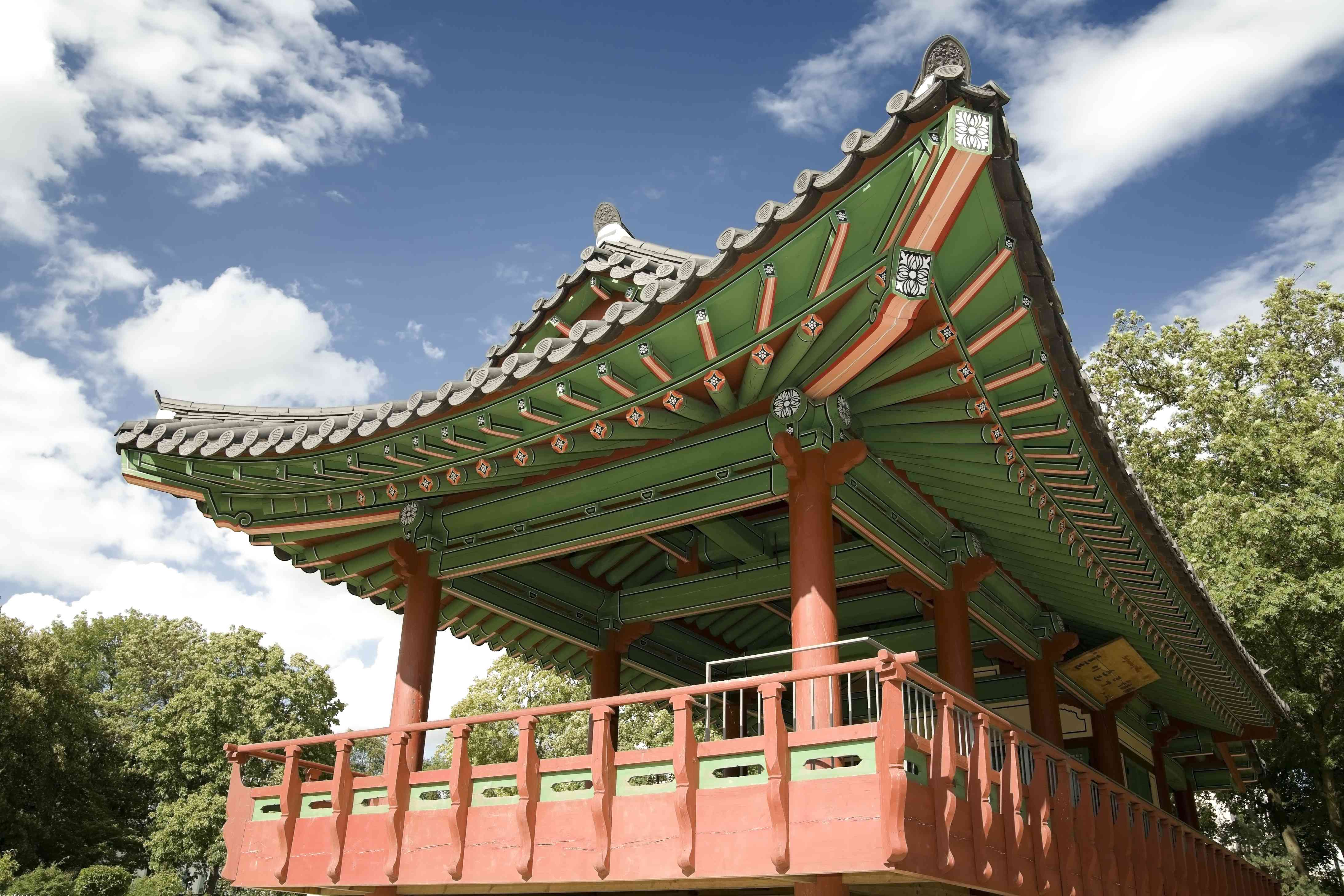 low angle view of a Korean pagoda with terracotta and green details