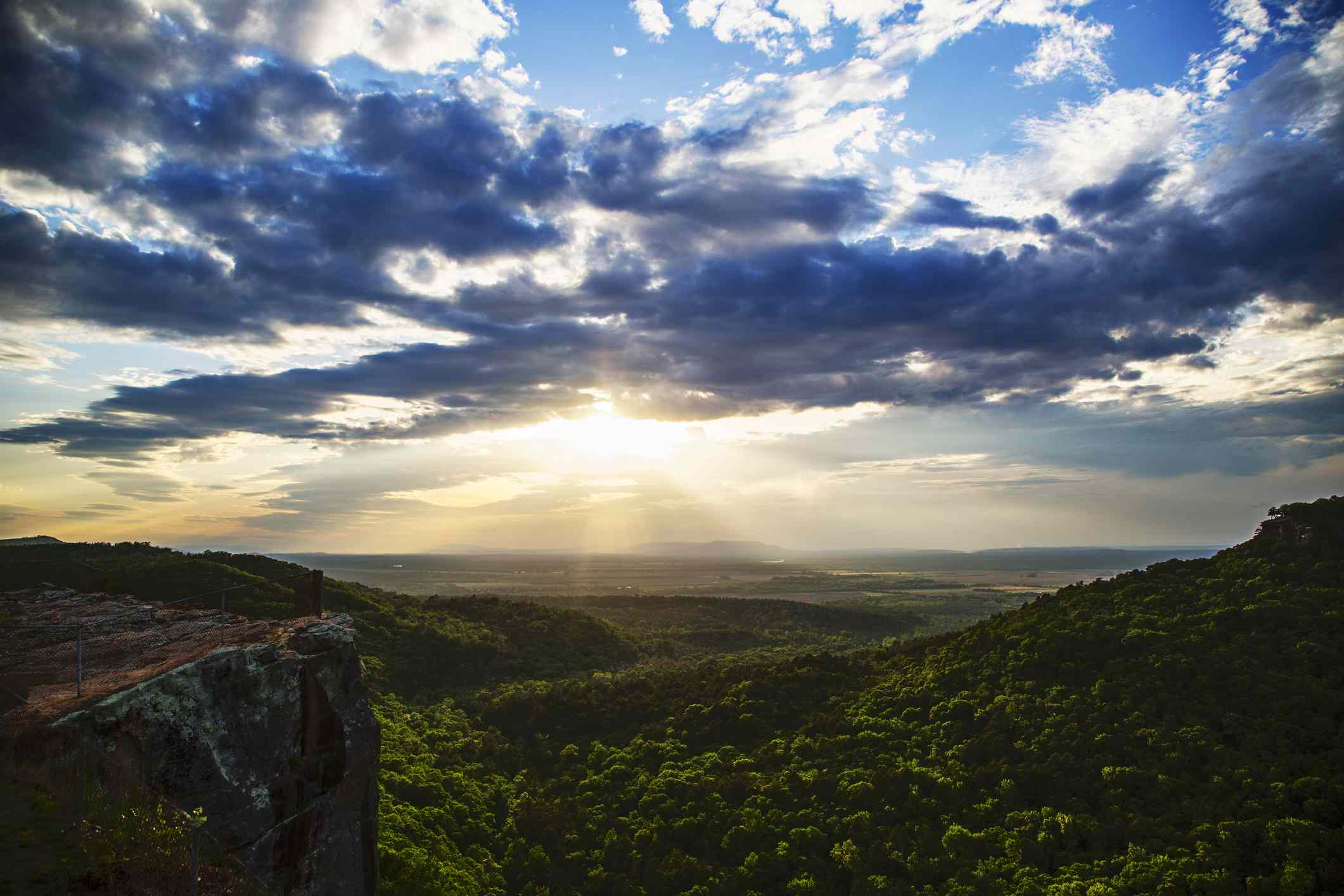 View of sunset over the Arkansas River Valley from Petit Jean Mountain.