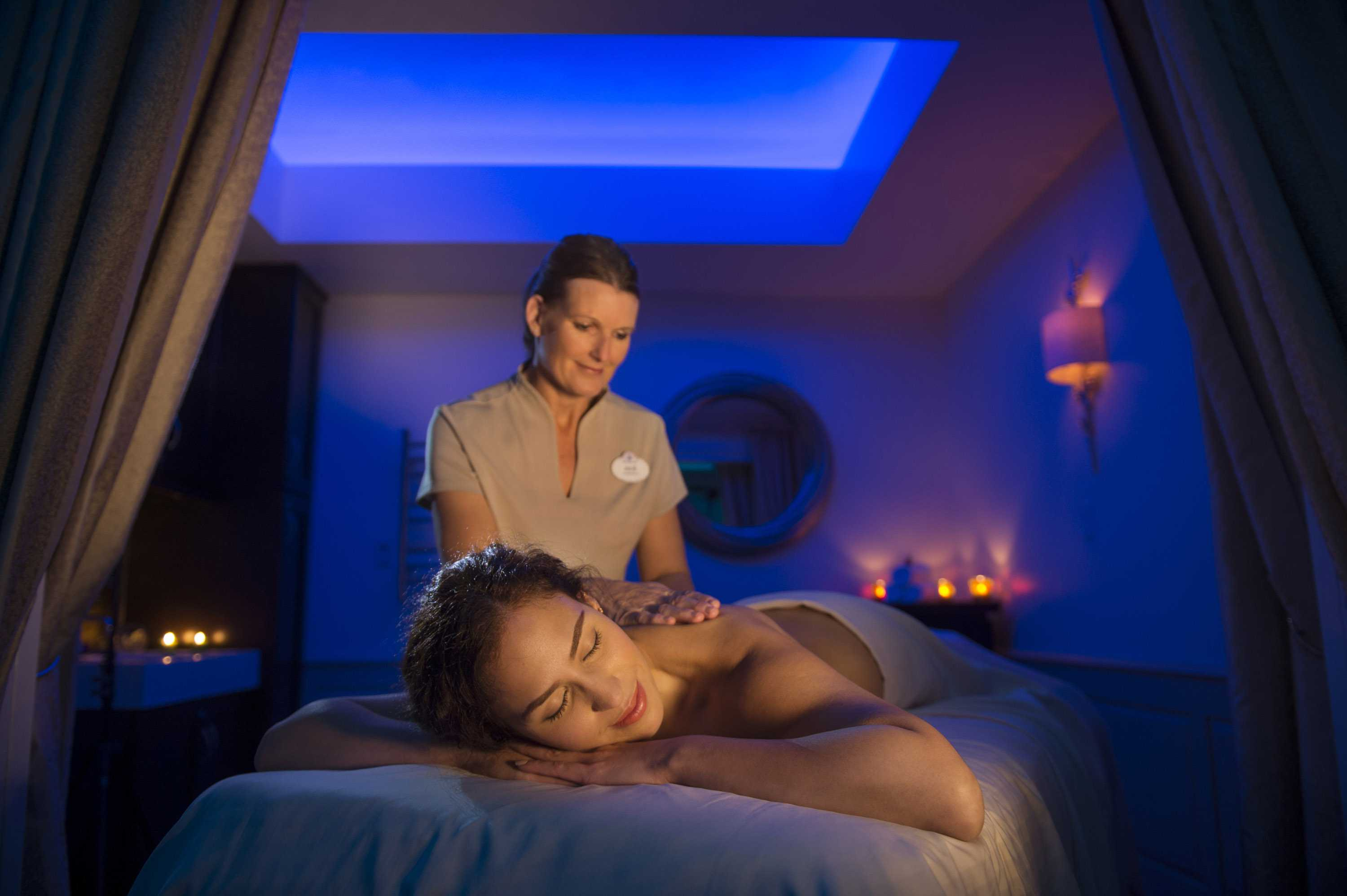 Woman getting a massage at Senses Spa at the Grand Floridian Resort