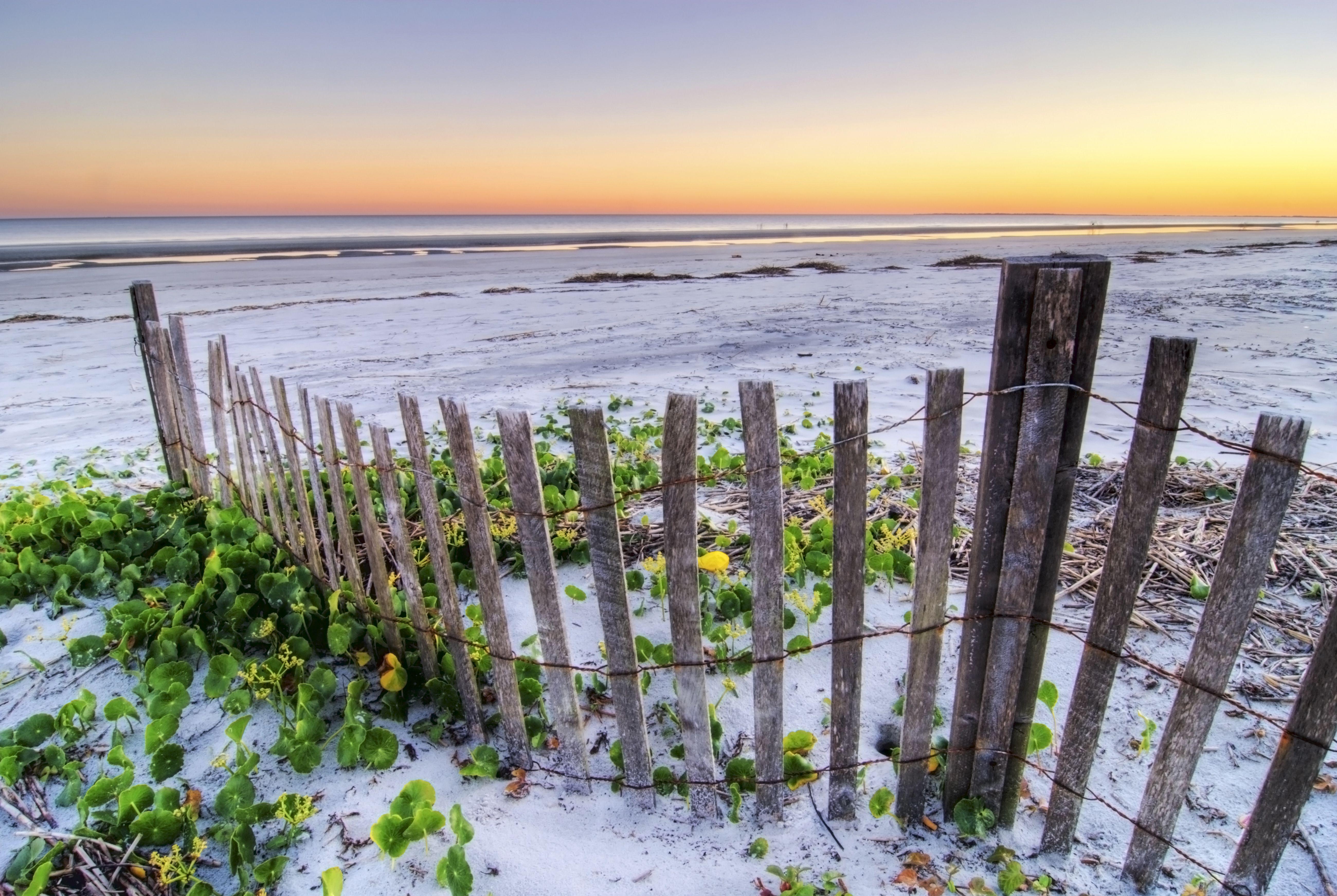 beach fence at sunset on Hilton Head Island, South Carolina.