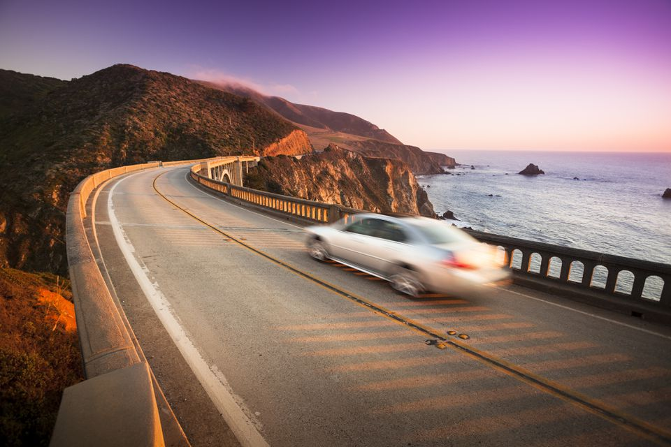 Car crossing the Bixby Bridge, Big Sur, California, USA