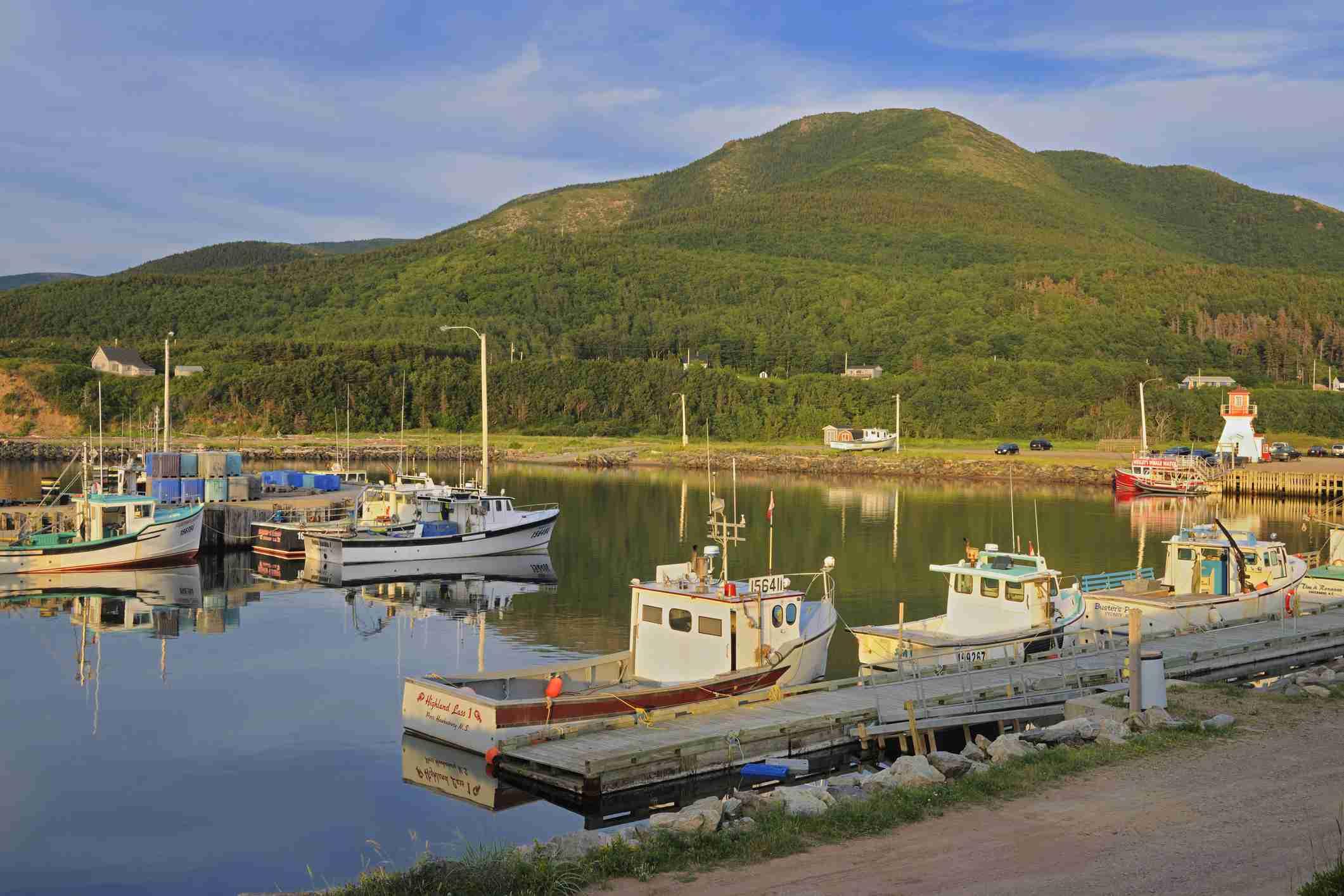 Fishing boats on Cape Breton Pleasant Bay Nova Scotia Canada