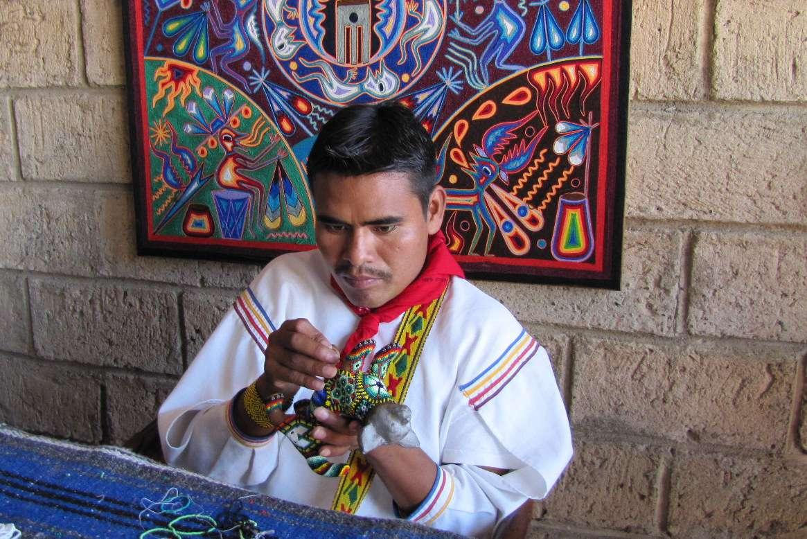 A Huichol artisan at work beading
