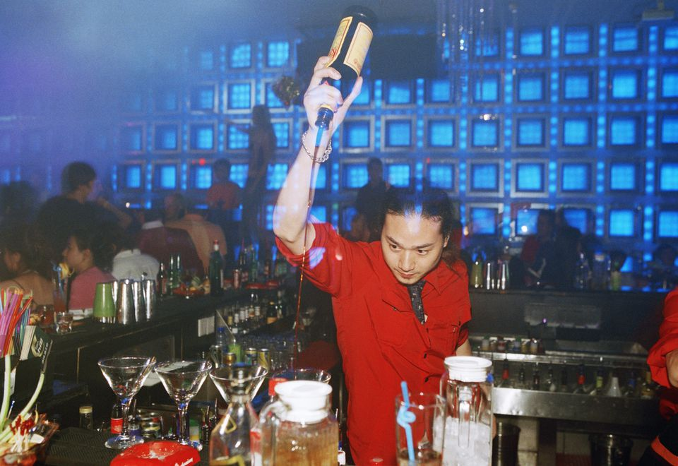 Mixing Cocktails with a Little Flash, a Bartender Mixes Cocktails at Babyface Club