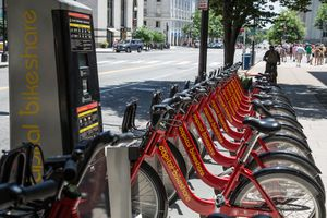 A row of bikes docked at a station for Capital bike share