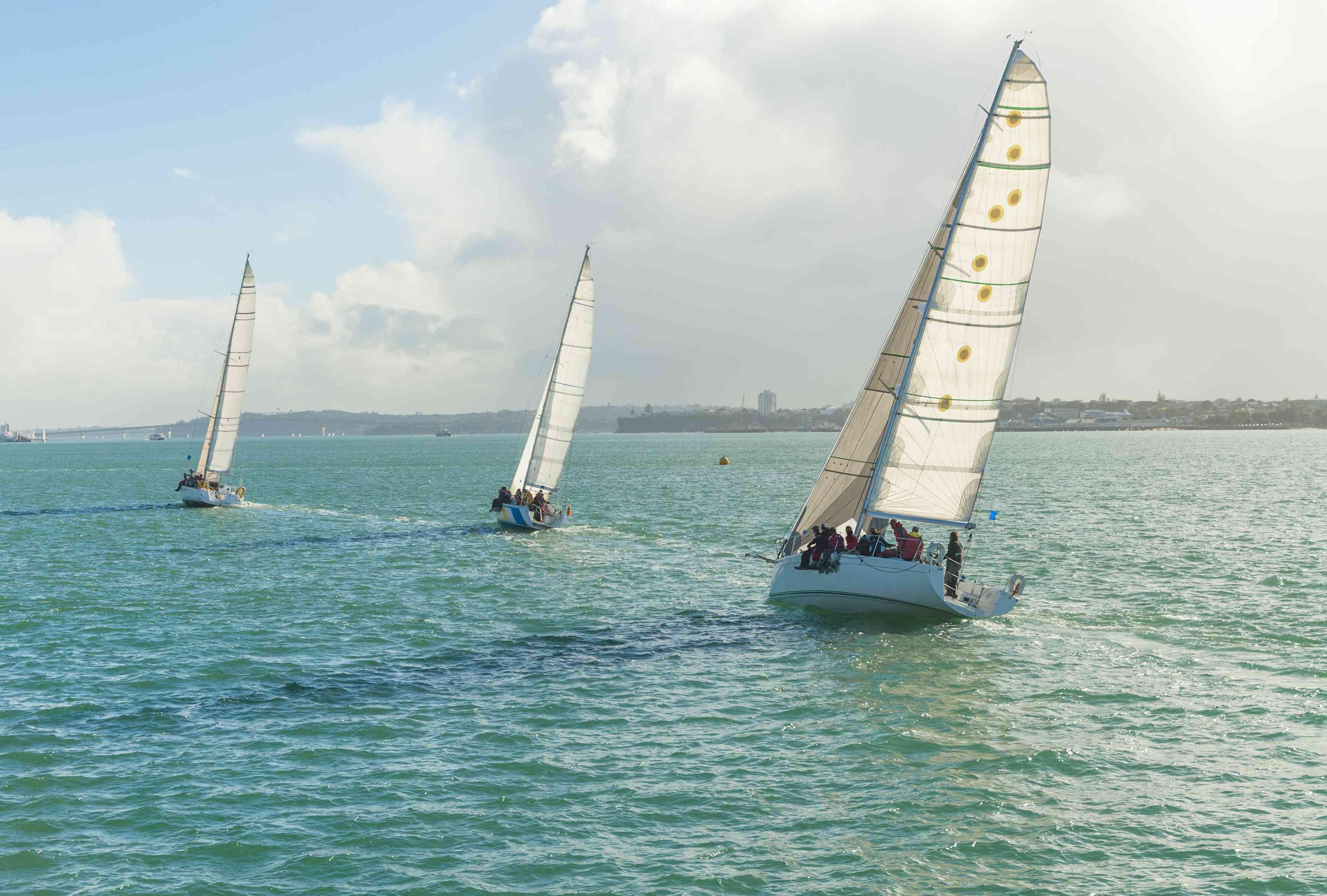 three yachts racing