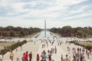 Tourists Visiting World War Ii Memorial Against Sky