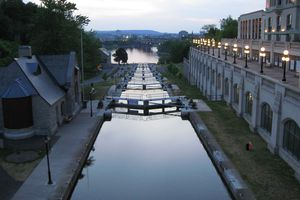 A view of the historic Rideau Canal, as it drops down to the Ottawa River via a series of locks - note the ByTown Museum on the left, and the neighboring city of Hull, Quebec, just across the river in the distance
